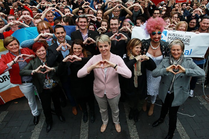 (L-R)Christine Forster, Virginia Edwards, Greens Senator Sarah Hanson-Young, politician Tanya Plibersek (C), Jackie Stricker and Dr Kerryn Phelps make a love heart sign with their hands signalling for marriage equality on May 31, 2015 in Sydney, Australia. Demonstrators are calling on the government to allow for a free vote on marriage equality. (May 30, 2015 - Source: Lisa Maree Williams/Getty Images AsiaPac)