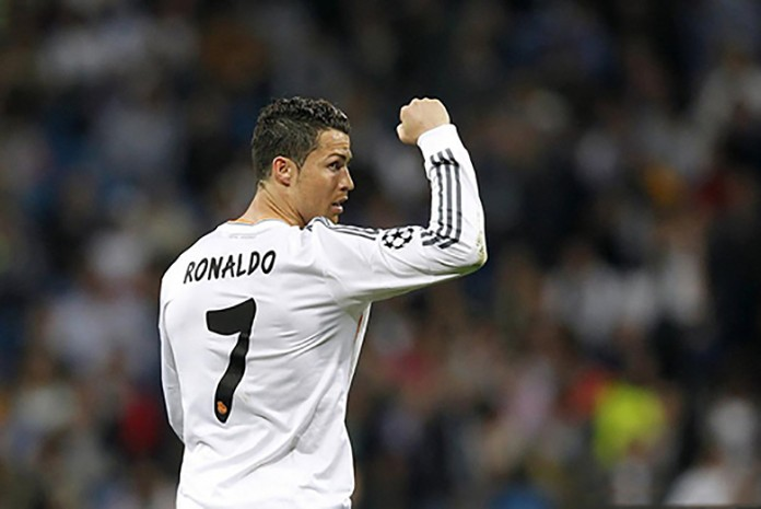 Cristiano Ronaldo showing his strength by raising his right fist after the winning goal against Barcelona.
