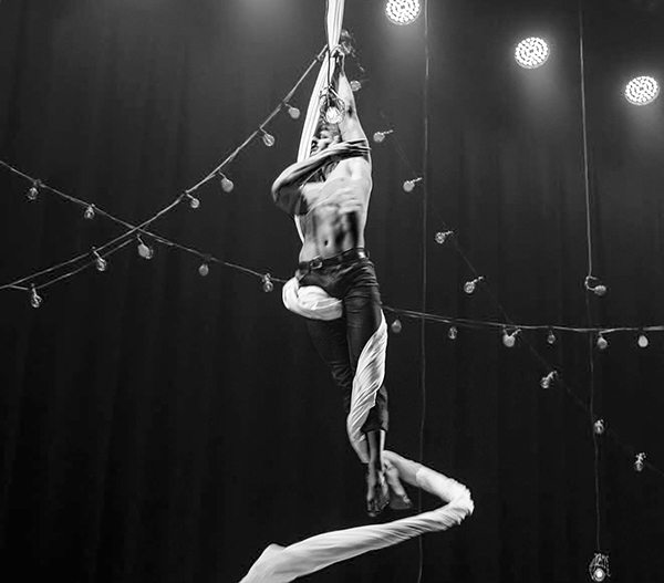 Jack performing as an aerialist as part of his dancing career which he continues with on a part time basis - Supplied