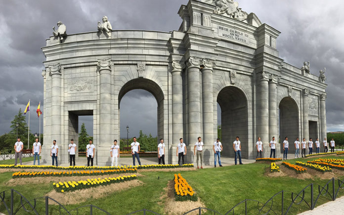 2017 Mr Gay World delegates standing in front of a replica of the Madrid Puerta de Alcalá at the Parque Europa on the outskirts of Madrid. (Mr Gay World)