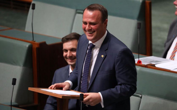 MP Tim Wilson proposes to his partner Ryan on the floor of Federal Parliament today during the same-sex marriage debate (ABC Online)