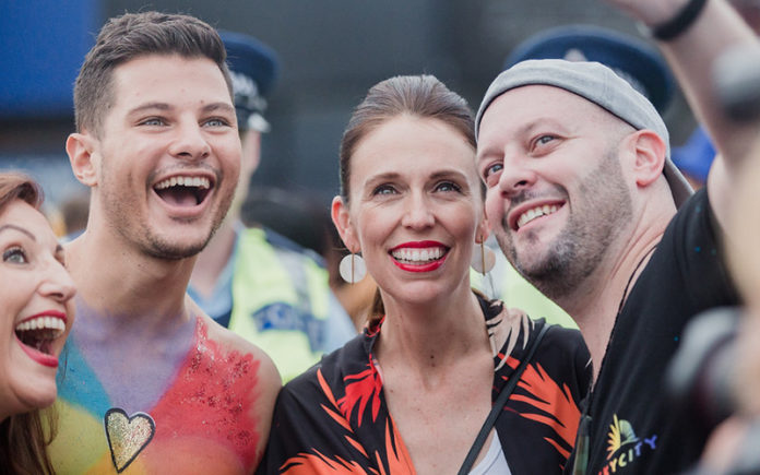 New Zealand Prime Minister Jacinda Ardern at the Auckland Pride Parade grabbing a selfie with Mr Gay Pride Australia 2018 Jordan Bruno - Source: Maria Ligaya http://www.marialigayaphotography.com