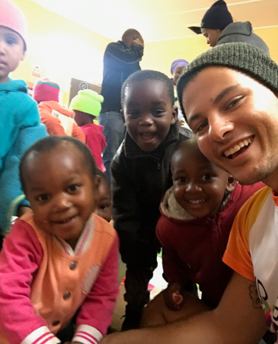 Mr Gay World 2018 Jordan Bruno visiting an orphanage in Knysna (Supplied)