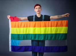 Olly Alexander with the ripped rainbow flag (Youtube)