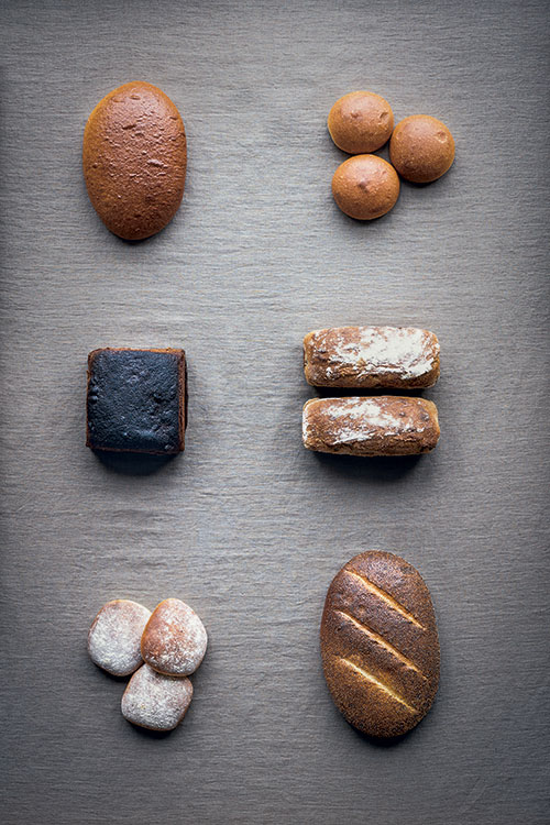 Breads based on wheat flour, clockwise from top left: Golden Syrup Loaf; Danish Birthday Buns; Icelandic Potato Bread; Wheat Loaf with Poppy Seeds; Overnight Breakfast Buns; Wort Loaf. Photography by Magnus Nilsson (page 103)