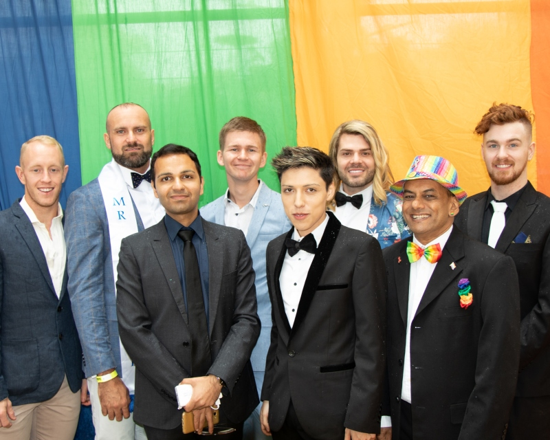 Mr Gay Pride Australia 2019 Finalists at ChillOut Festival Carnival in Daylesford (L-R Rhys Cameron, Rad Mitic, Prashant Bhatia, Liam Davies,   Andre Cordova, Justin Hill, Johann De Joodt & Darby Savage) (Photo credit - Fred LeMarche - The Boy Project)