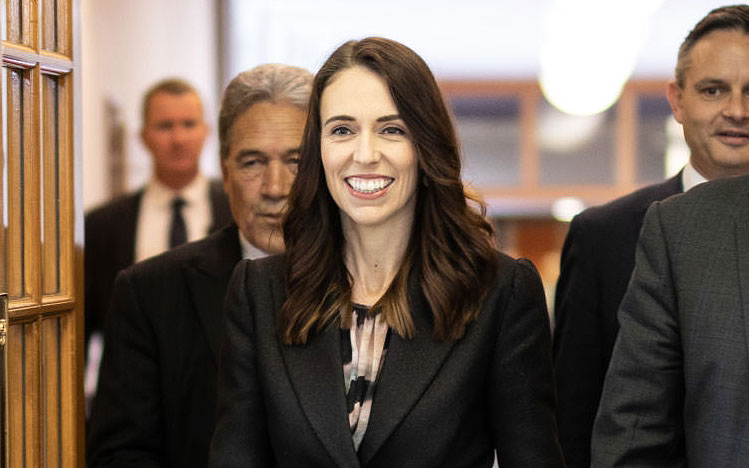 Jacinda Ardern in front of Winston Peters NZ First