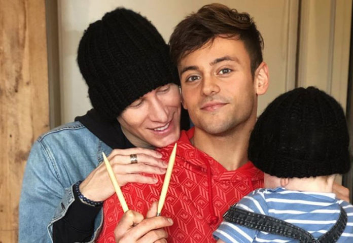 gay couple Dustin Lance Black and Tom Daley with their baby.