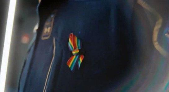 Rainbow flag pin on Branson's space suit (Twitter)