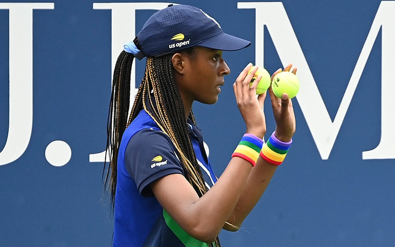 A ballperson wearing Pride wristbands in a match at the US Open.